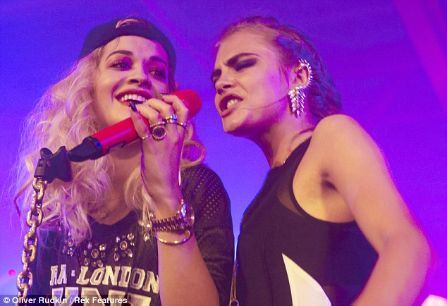 Having a go: Rita looked happy while Cara gave the singing a go