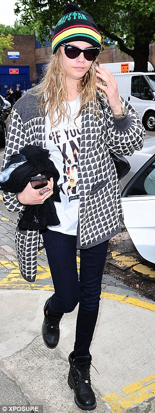 No rest for the wicked: Cara was spotted on Thursday morning with her hair still wet as she left the house