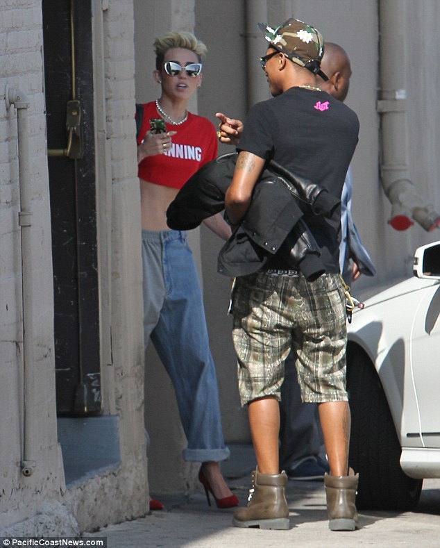 Chummy musicians: The Climb singer greeted Pharrell Williams as she arrived at Jimmy Kimmel Live for a taped appearance
