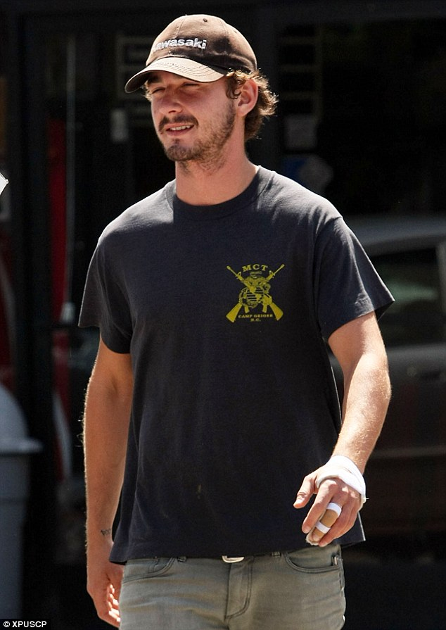 Injured star: Shia LaBeouf has his left hand bandaged following surgery after his he flipped his truck while filming Transformers 2 in 2008