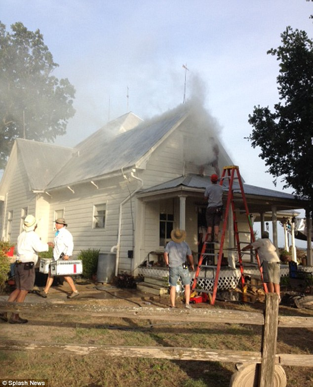 Panic: Crew members removed equipment from the house after smelling smoke