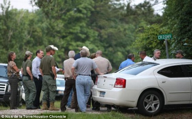 Investigation over: Police gather near Bankston and Charlton's backyard while investigating Gridley's tip