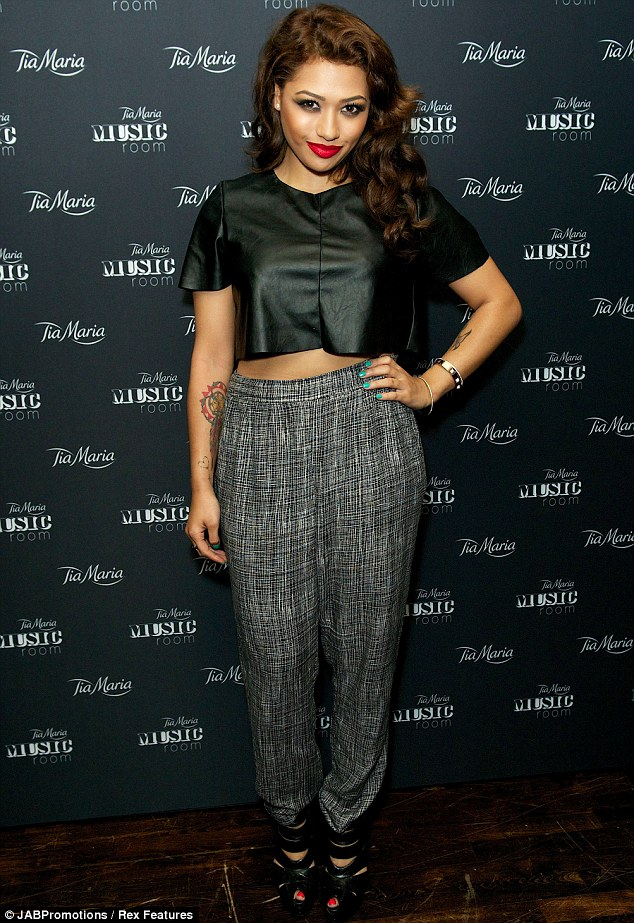 Night off: She took a break from her bandmates to enjoy the music at the launch as she showed off her style in her trouser outfit