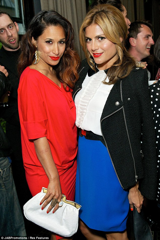 Splash of colour: Preeya Kalidas stood out in her bright red frock as she mingled inside to the sound of Laura Mvula singing