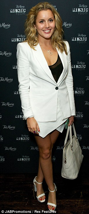 Ladies in white: Former Made In Chelsea star Caggie Dunlop joined singer Lianne Di Havas at the party at the Century Club in central London