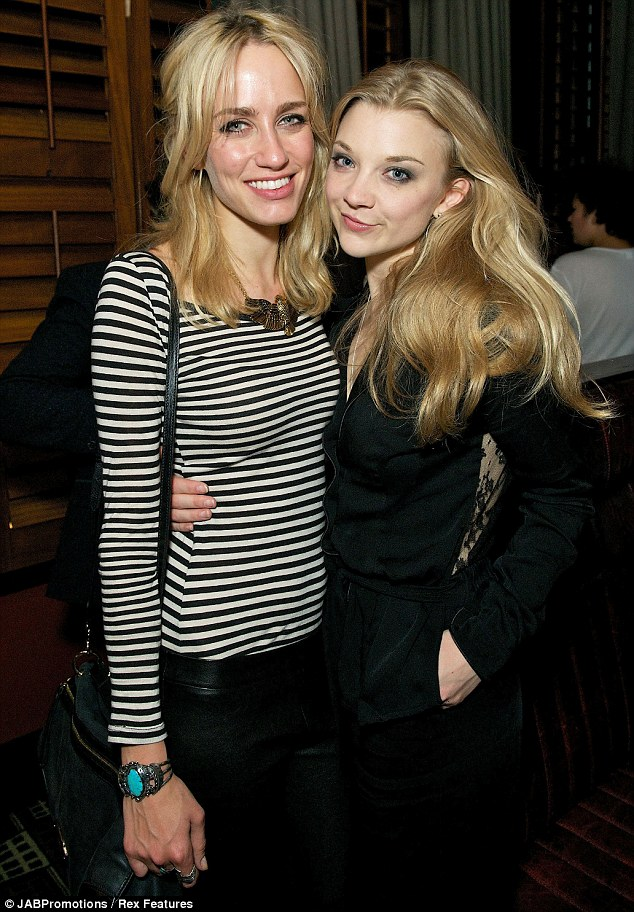 Cuddling up: Ruta Gedmintas and Natalie Dormer looked pleased to see each other as they caught up at the party