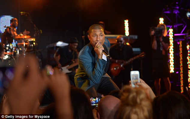 Entertainment: Pharrell kept guests entertained at the event with his musical talents