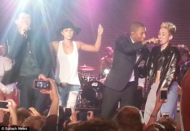 Join us! Pharrell and RobinThicke also got Miley on stage later in the evening
