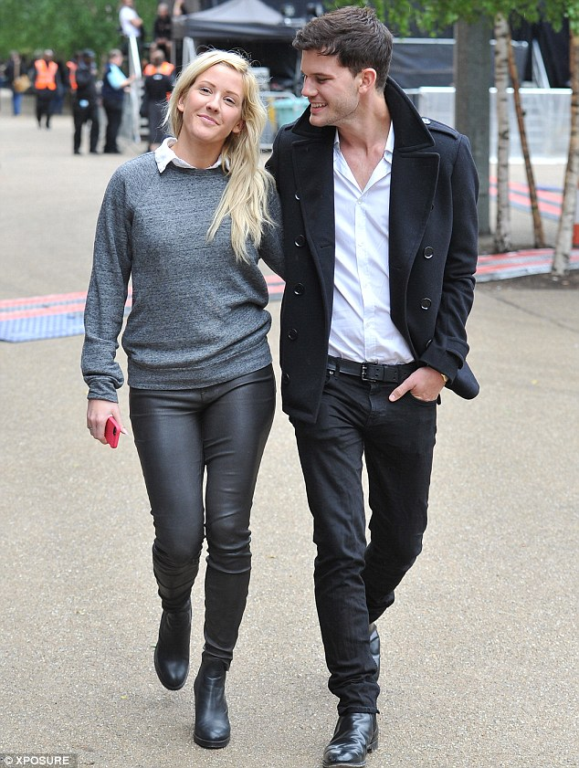 The look of love: Jeremy gazed adoringly at his girlfriend as they strolled up the south bank arm in arm
