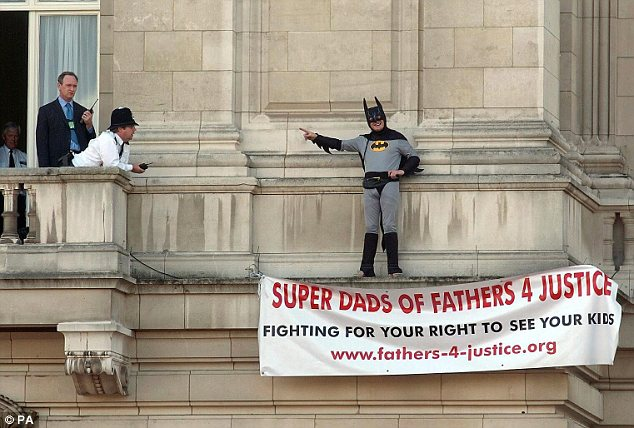 Stunt: Fathers4Justice's most famous protest came in 2004, when Jason Hatch scaled Buckingham Palace dressed as Batman