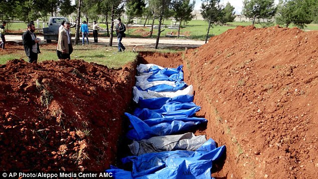 Toll of civil war: A picture taken in April shows a mass grave of people allegedly killed by Syrian forces. Nearly 93,000 people have been killed in the conflict, the UN said today