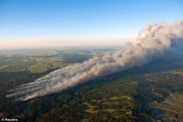 Huge: Nearly 40,000 have fled a massive wildfire that has been scorching Colorado Springs since Tuesday