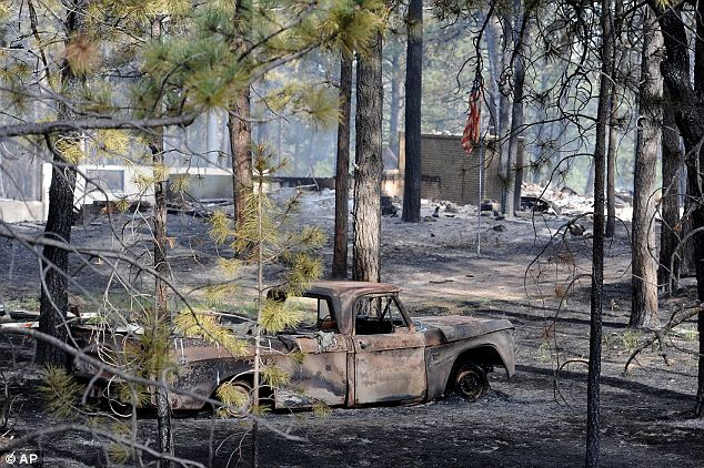 Wasteland: A charred truck outside Colorado Springs Wednesday. Nearly 400 homes have burned since Tuesday and favorable fire conditions mean those numbers could rise