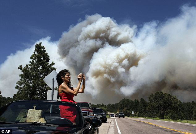 Burn notice: Evacuation notices forced thousands from their homes, causing traffic jams around Colorado Springs as people fled, smoke rising behind them