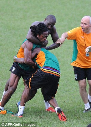 Rumble: Players and staff alike tried desperately to split up the players, who have both been sent home