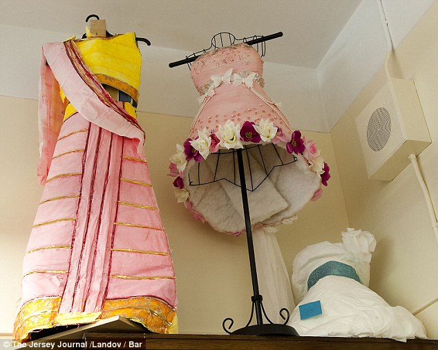 Cultural influence: The toilet paper gown to the left appears to be modeled on traditional Indian wear
