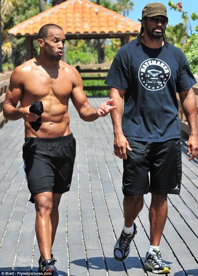 Pretty fit: Craig outshone boxer David Haye when they hit the beach together in 2011 as, even then, he was in brilliant shape
