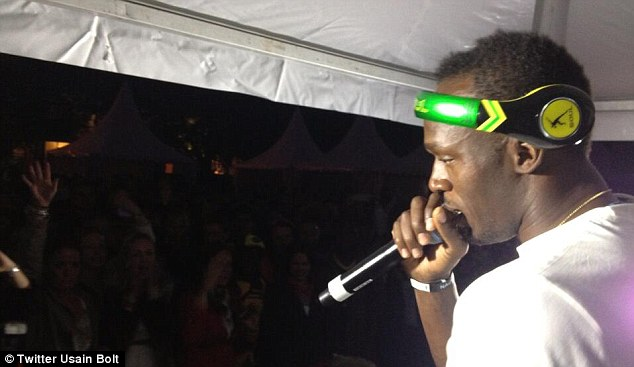 Singing away: bolt even gave the microphone some of his handy lyrics