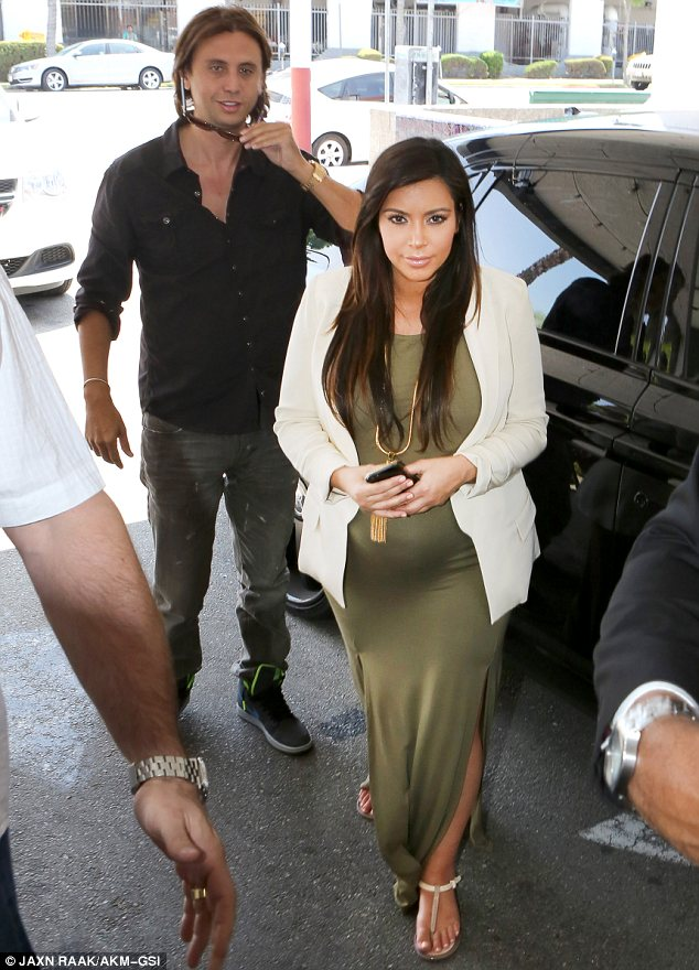Carrying on as normal: The pair went for lunch in San Fernando Valley on Wednesday and were filming for Kim's reality show Keeping Up With The Kardashians
