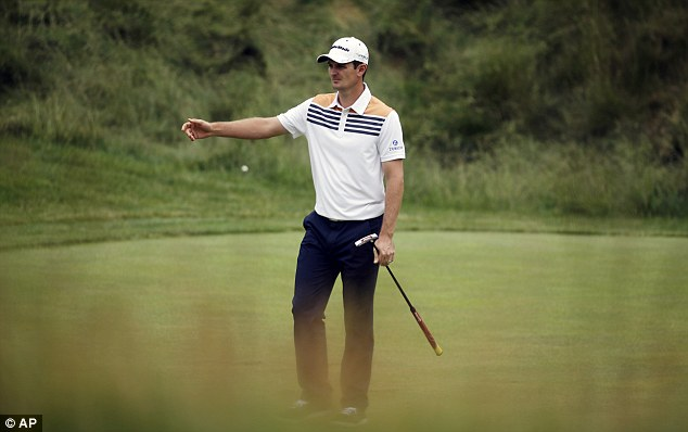 Annoyance: Justin Rose shows his frustration after a wayward putt on the 17th