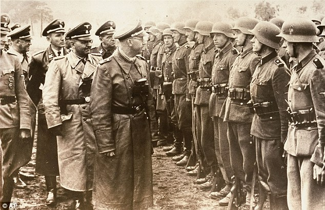 This 1944 photo shows head of the SS Heinrich Himmler, centre, reviewing troops of the Galician SS-Volunteer Infantry Division, of which Michael Karkoc is said to have become a member