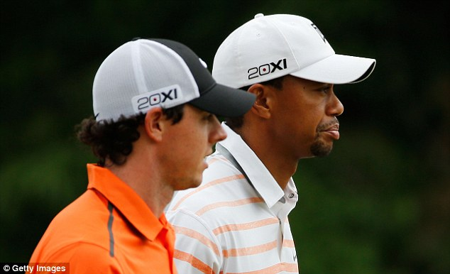 Pace for pace: Rory McIlroy and Tiger Woods have matched each other in both rounds, ending three over