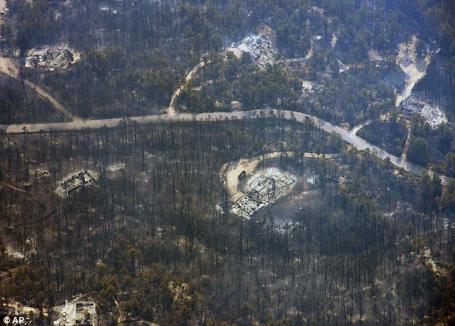 The blaze is now the most destructive in Colorado history, surpassing last year's Waldo Canyon fire, which burned 347 homes, killed two people and led to $353 million in insurance claims