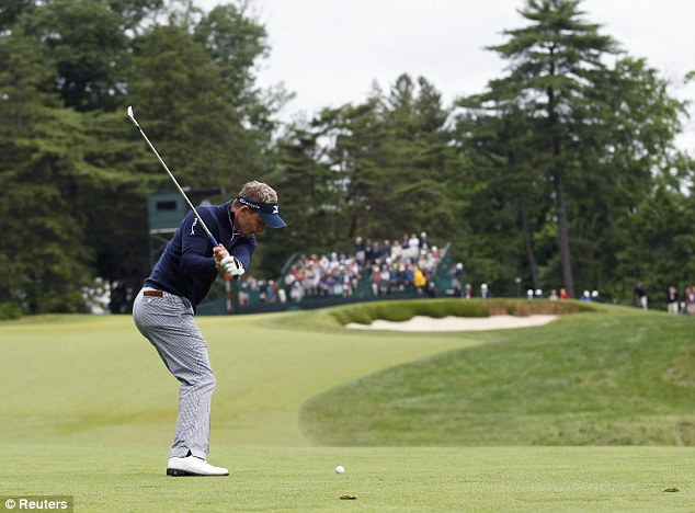 Nice approach: Luke Donald hits on the 15th hole on Friday morning as the Englishman resumed his first round