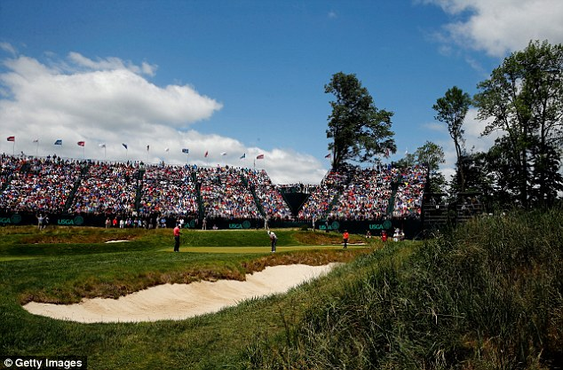 Sun is shining: Tiger Woods putts on the 17th green during round two at Merion
