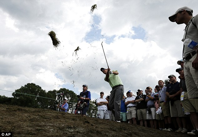 Belgian bomber: Nicolas Colsaerts hits from among the gallery on the fourth hole