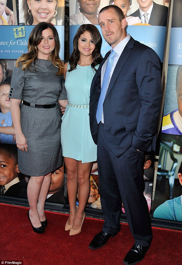 Happy family: Selena is on good terms with her mother Mandy and her step father Brian Teefey who now share a daughter together