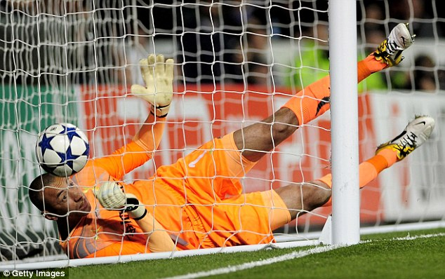 Goalkeeper Heurelho Gomes of Spurs can't stop Cristiano Ronaldo of Real Madrid scoring their first goal during the UEFA Champions League quarter final second leg