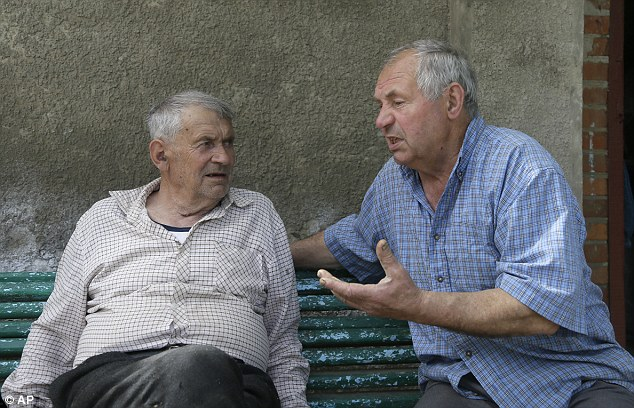 Heorhiy Syvyi, 78, left, with Ivan Hrushka, remembers hiding from the Germans as a nine-year-old when they stormed Pidhaitsi. He and his father survived but his mother and four-year-old brother did not