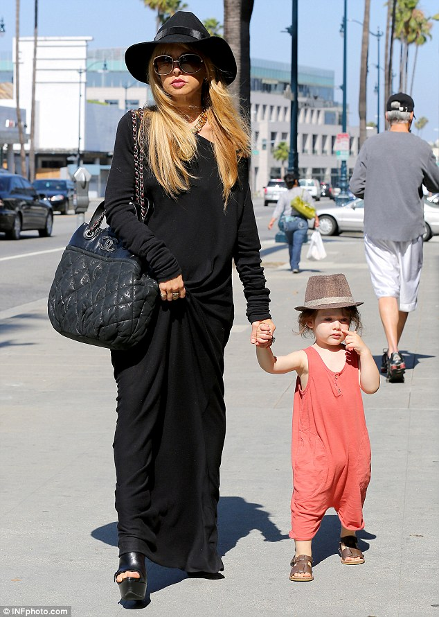 In her image: Rachel is known for dressing up her toddler in similar styles to her own