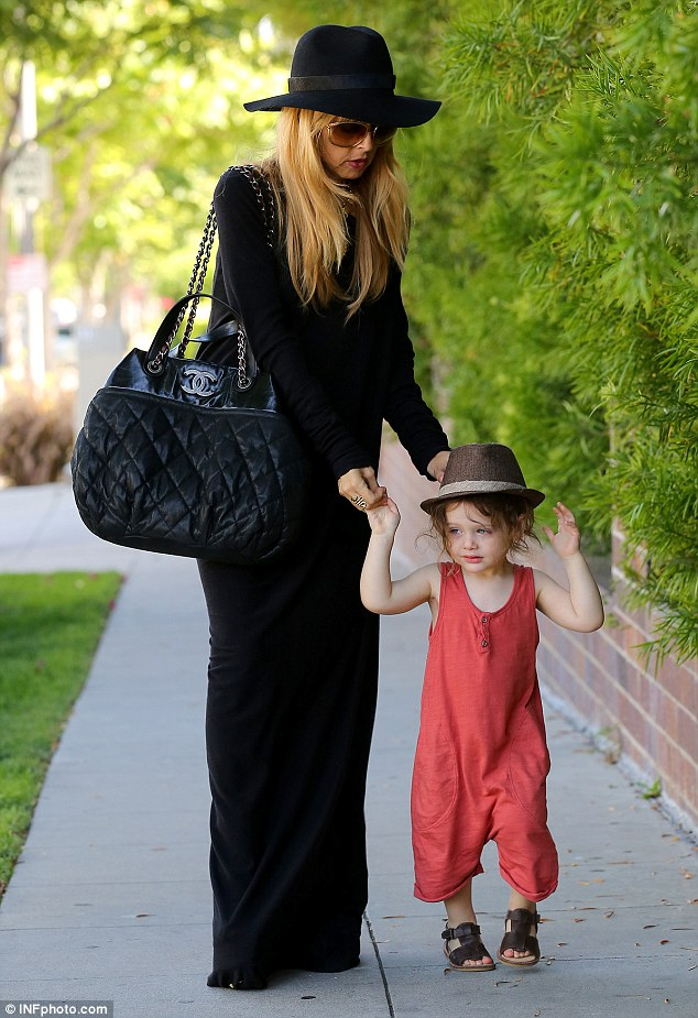 Quick cuts: Rachel Zoe son Skyler's flowing curls beneath his hat as they went shopping in Beverly Hills on Thursday