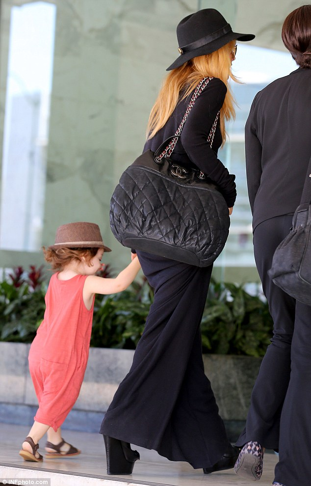 What long hair? The celebrity stylist pulled her son's curly brown hair into a high pony tail