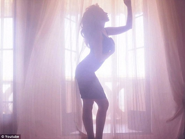 Sexy silhouette: Kylie sizzles in the new lyric video for her latest dancefloor filling track