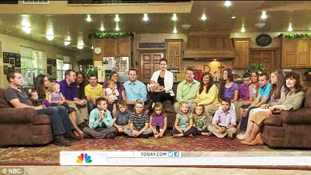 The clan: Michelle and Jim Bob boast 19 children and a growing contingent of grand kids