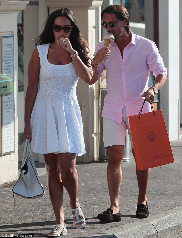Goodbye, diet: The couple happily slurped on their sweet treats as they wandered through the streets of St Tropez