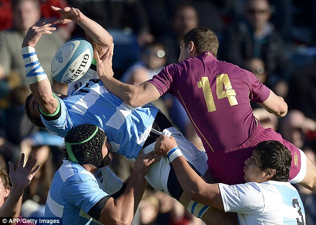 Arms race: Pumas flanker Julio Farias Cabello (top) vies for the ball with Jonny May