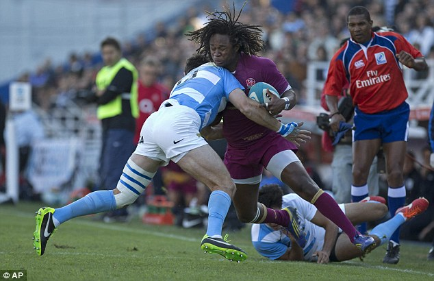 No way through: Marlan Yarde is tackled by Gonzalo Tiesi (left) and Martin Bustos Moyano