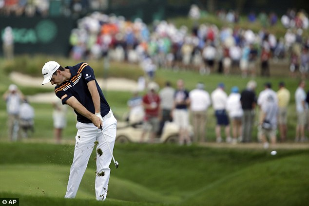 Front runner: Justin Rose hits on the fifth hole during the second round