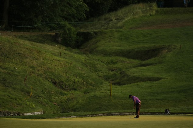 Late starter: Jaco Van Zyl, of South Africa, putts on the ninth hole