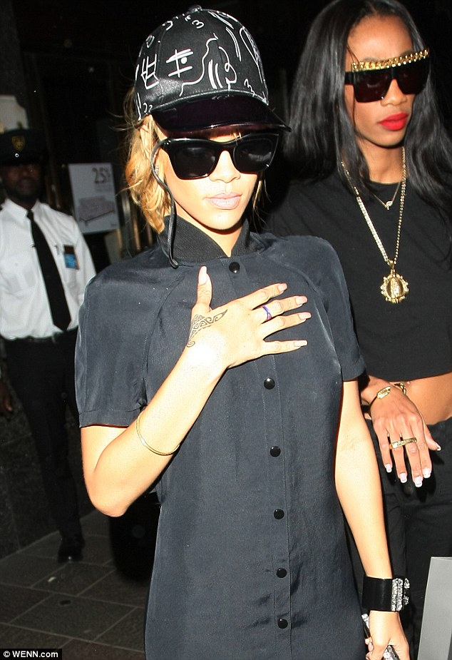 Shop 'til you drop! Rihanna ensured the first stop on her tour of London was a visit to swanky department store, Harrods
