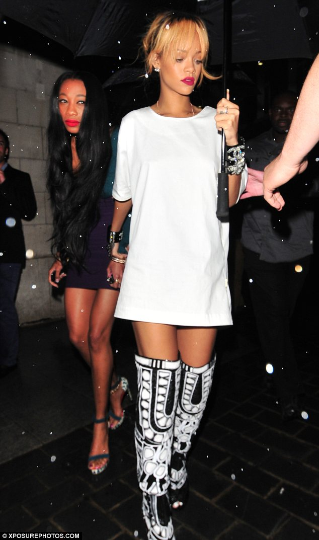 These boots were made for.... partying: Rihanna hit the town in London on Friday night in a pair of unusual over-the-knee boots