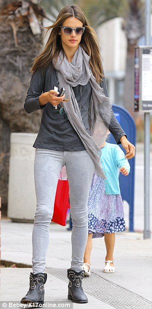 Look closer: The 32-year-old supermodel slipped her slim pins into a pair of skinny jeans etched with ghostly paisley print
