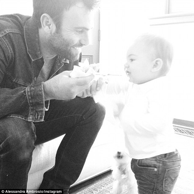 Her two leading men: Ambrosio's fiancé of five years businessman Jamie Mazur plays with their 14-month-old son Noah