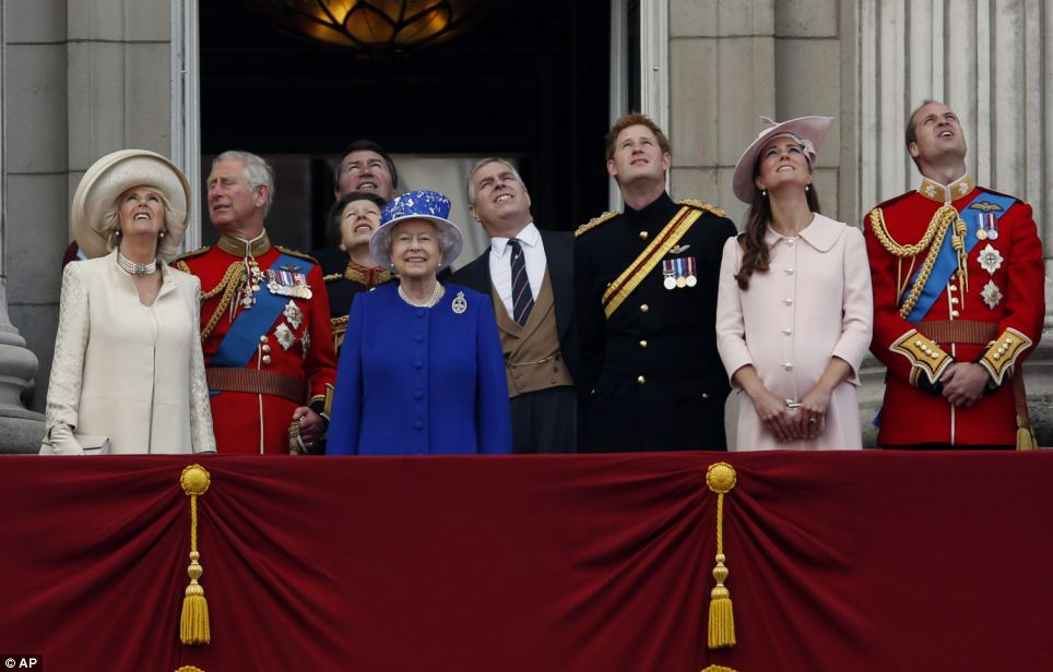 The queen was surrounded by members of her family, who watched a Royal Air Force fly pass by on the balcony of Buckingham Palace