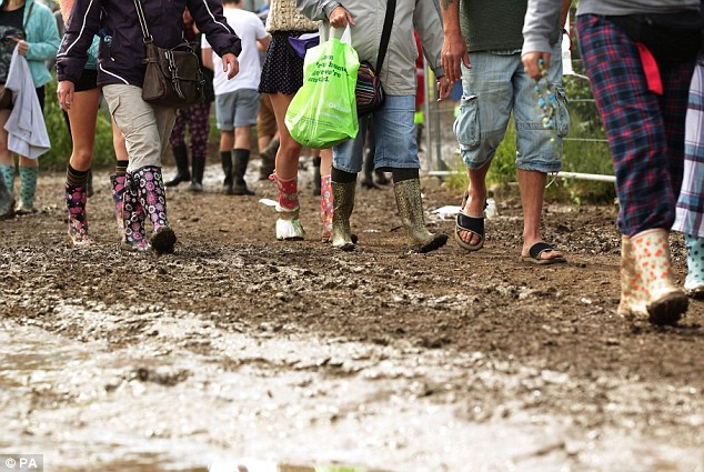 Slippy: The mud follows heavy rain in the last few days. But many festival lovers are carrying on regardless