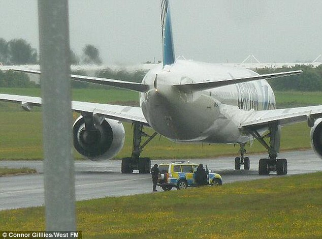 Stranded: The Egyptair flight remains in a secluded part of the airport with 326 passengers on board